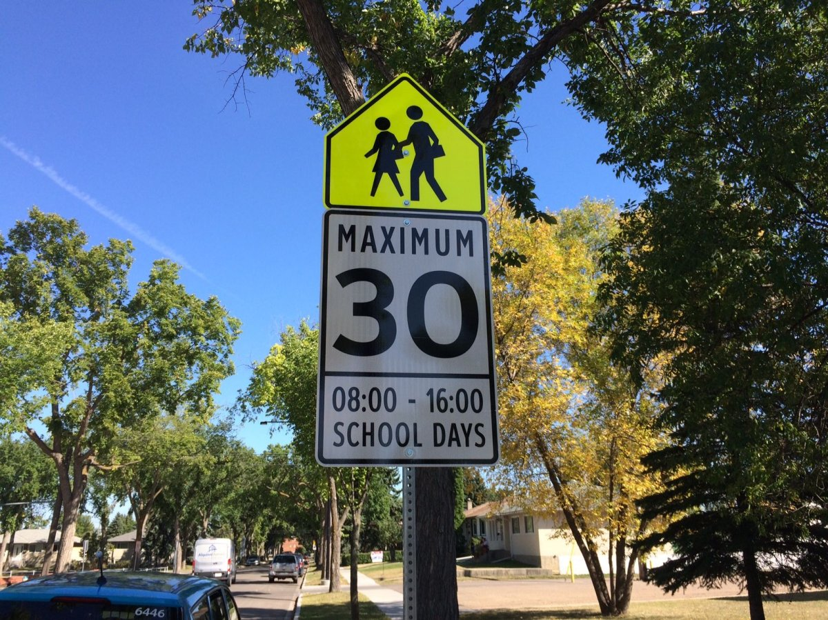 School zone speed limit signs read 8 - 4 p.m. outside St. Mark's Junior High School in Edmonton near 116 Avenue and 135 Street. Sept. 4, 2017.