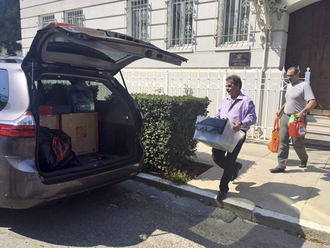 Workers carry boxes out of the Russian consulate in San Francisco, Sept. 1, 2017.