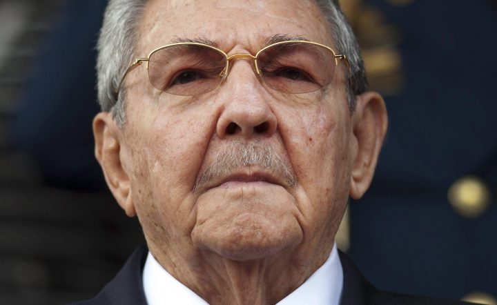 FILE - In this March 17, 2015 file photo, Cuba's President Raul Castro listens to the playing of national hymns during his welcoming ceremony at Miraflores presidential palace before the start of an emergency ALBA meeting in Caracas, Venezuela.