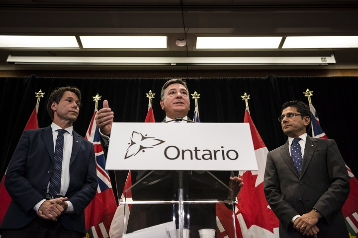 Minister of Finance, Charles Sousa, centre, Attorney General, Yasir Naqvi, right, and Minister of Health and Long-Term Care, Eric Hoskins speak during a press conference where they detailed Ontario's solution for recreational marijuana sales, in Toronto last Friday.