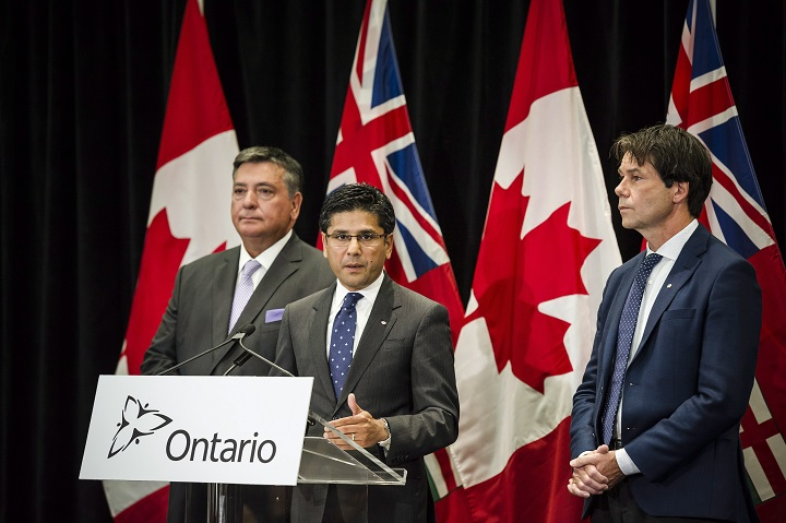 Attorney General Yasir Naqvi, centre, Minister of Finance Charles Sousa, left, and Minister of Health and Long-Term Care Eric Hoskins speak during a press conference where they detailed Ontario's solution for recreational marijuana sales, in Toronto on Friday.