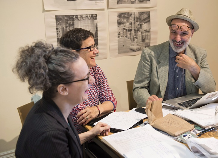 Musician and writer Dave Bidini, right, smiles as he attends a staff meeting in Toronto on Wednesday, Sept.13, 2017. Bidini is launching a monthly newspaper, the non-profit West End Phoenix, that is focussed on a downtown Toronto area.