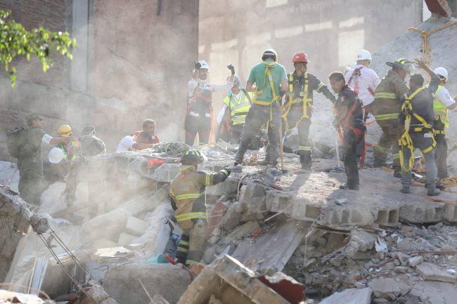 First responders work on removing the rubble of a collapsed building looking for survivors trapped underneath, after a 7.1 earthquake in Mexico City, Tuesday, Sept. 19, 2017.  The earthquake stunned central Mexico, killing more than 100 people as buildings collapsed in plumes of dust.