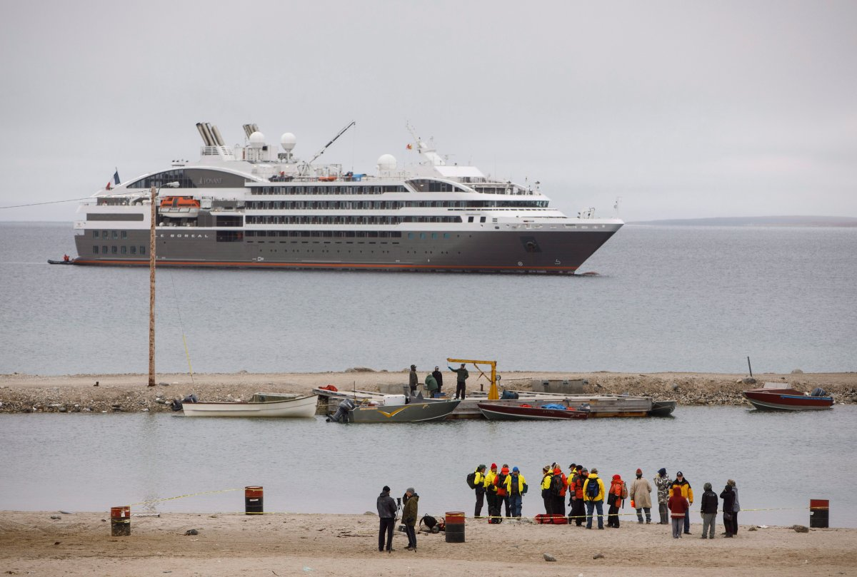 Passengers from a cruise ship reach the shore on zodiac boats during a visit to the town of Gjoa Haven, Nunavut on Saturday September 3, 2017.