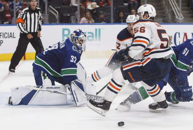 Vancouver Canucks' goalie Richard Bachman (32) makes the save on Edmonton Oilers' Kailer Yamamoto (56) during second period pre-season NHL action in Edmonton, Alta., on Friday September 22, 2017.