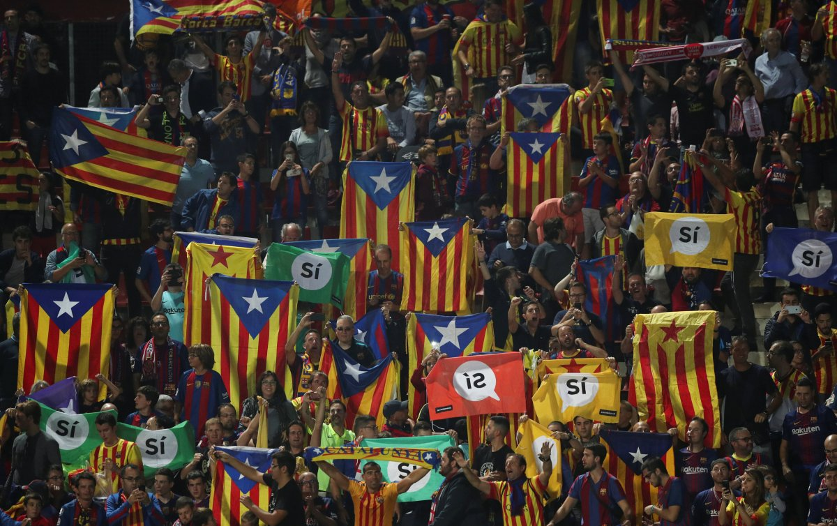 Fans raise pro-independence flags and banners during a Spanish La Liga match between Girona and Barcelona at Montilivi stadium in Girona, Spain, September 23, 2017. Picture taken September 23, 2017.