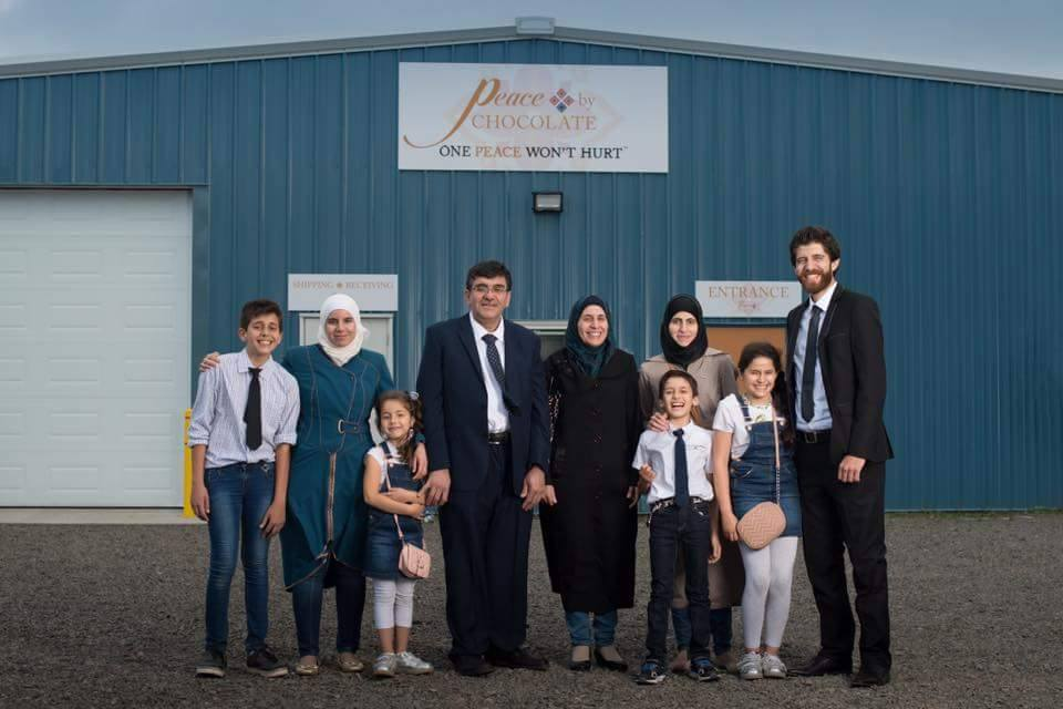 The Hadhad family poses in front of their new chocolate factory, which officially opened on Sept. 9 in Antigonish, N.S.