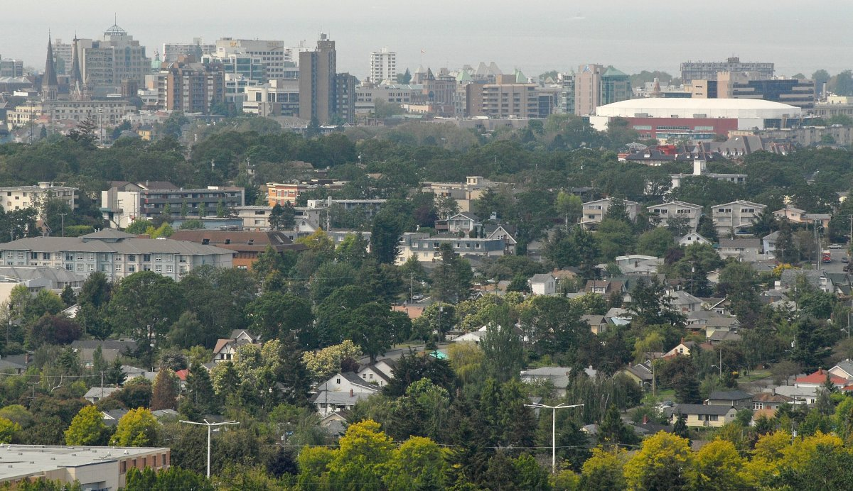 A view across housing to the skyline in downtown Victoria, British Columbia from the park on top of Mt. Tolmie. The large white building at top, right is the Save On Foods Memorial Arena.