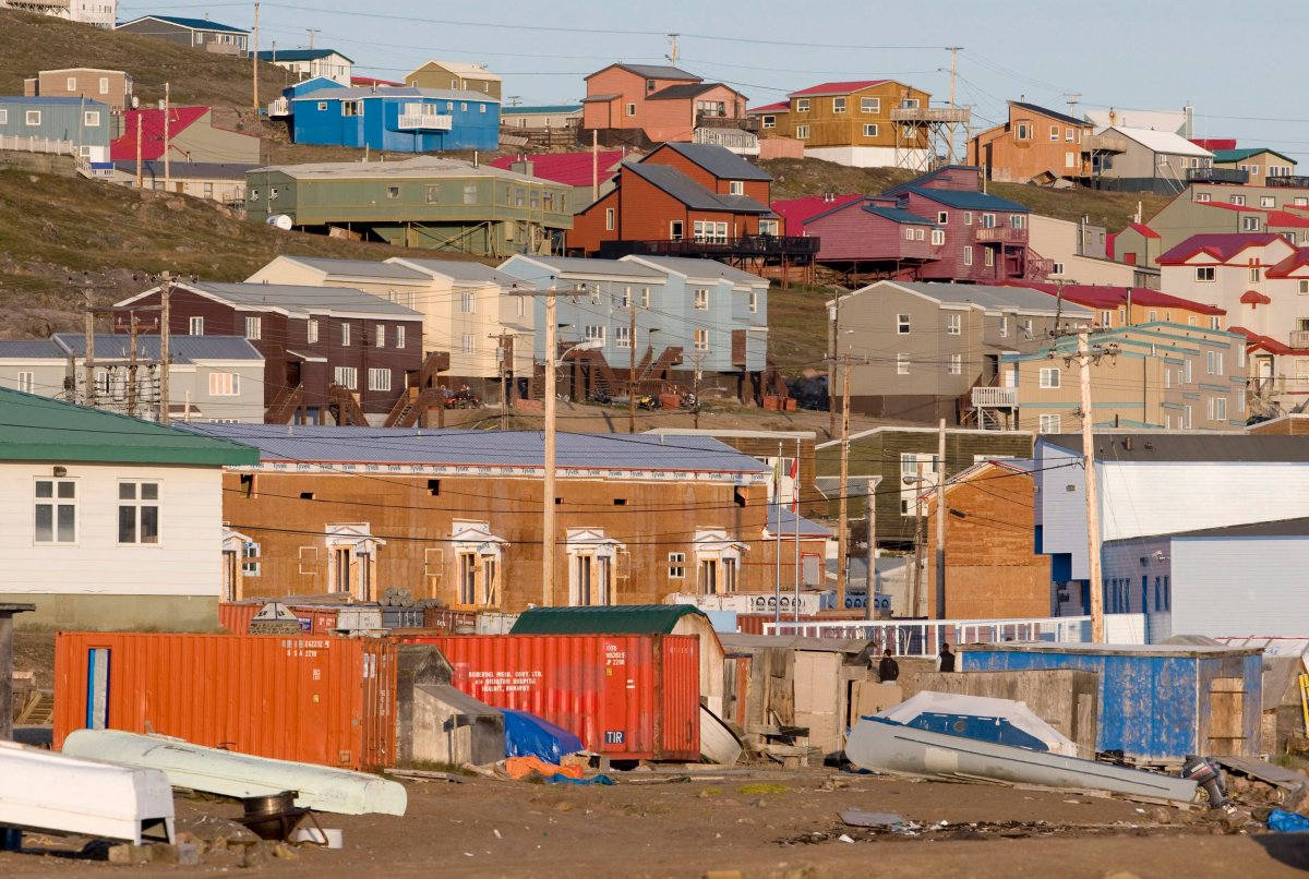 The sun sets on the buildings in Iqaluit, Nunavut, Friday, August 21, 2009.