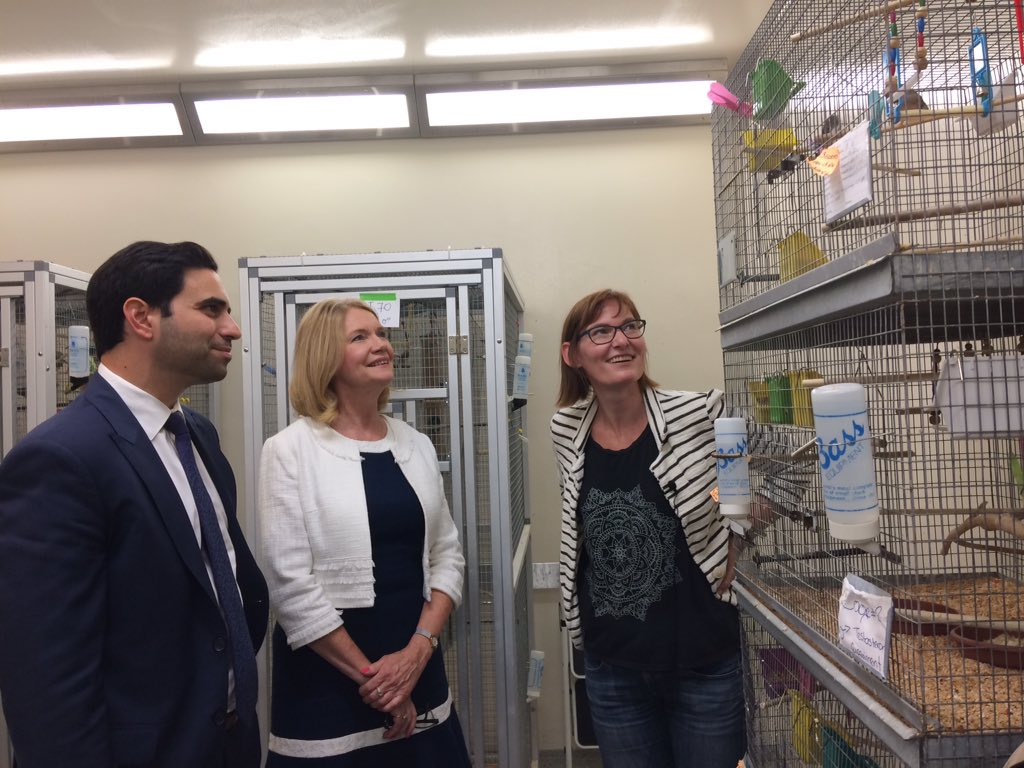 Beth MacDougall-Shackleton gives MPs Peter Fragiskatos and Kate Young a tour of the Advanced Facility for Avian Research on campus.