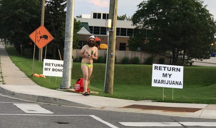 Jeffrey Shaver says police seized his bong and about two grams of marijuana, and he says he won't stop protesting until he gets them back.