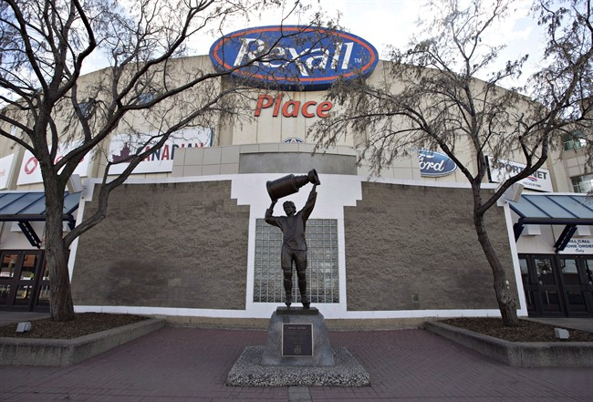 The Wayne Gretzky statue stands in front of Rexall Place home of the Edmonton Oilers in Edmonton, Alta., on Saturday April 2, 2016.