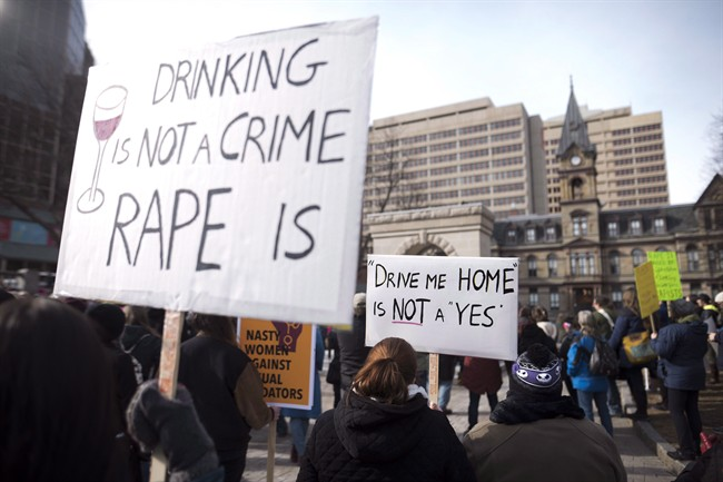 Demonstrators protest Judge Gregory Lenehan's decision to acquit a Halifax taxi driver charged with sexual assault during a rally in Halifax on March 7, 2017.