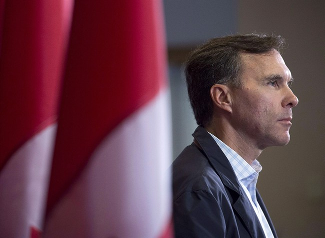 Finance Minister Bill Morneau takes questions as the Liberal cabinet meets in St. John's, N.L. on Tuesday, Sept. 12, 2017. Finance Minister Bill Morneau is putting the squeeze on federal New Democrats, chiding them for failing to support his proposals to end what he calls unfair tax advantages for some wealthy small business owners.