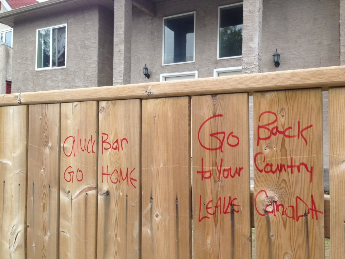 Racist graffiti was found on a Winnipeg fence outside of a Syrian refugee family's home.