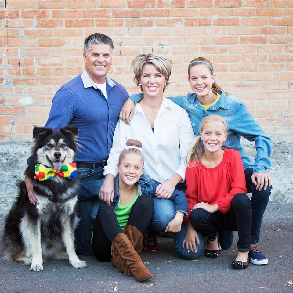 The Morris family's dog Fozzy (bottom left) went missing when it was inside their SUV that was stolen Sunday.