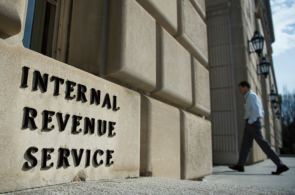 A man walks into the Internal Revenue Service building in Washington, DC on March 10, 2016.