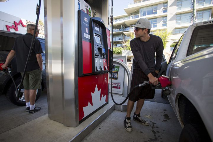 A file photo of a B.C. man filling his car with fuel at a gas station.