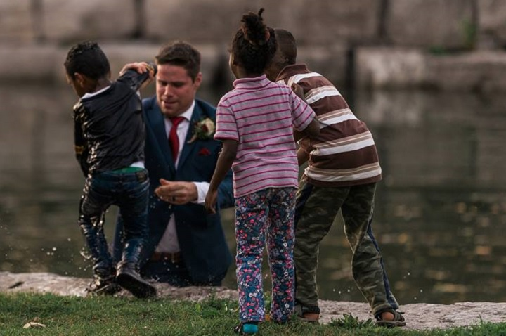 Photographer Darren Hatt captured photos of a groom pulling a boy from a river in Kitchener.