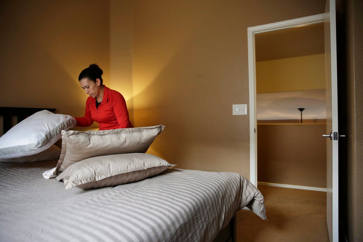 In this file photo a woman cleans a home that is rented out for short-term rentals, Monday, September 18, 2017.