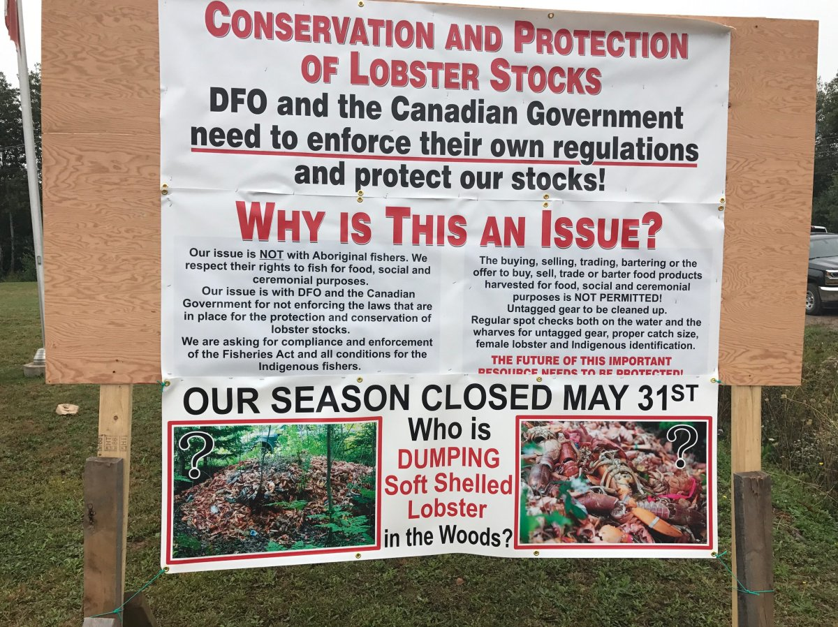 Signs posted by Nova Scotia fisherman outside the federal Fisheries office.
