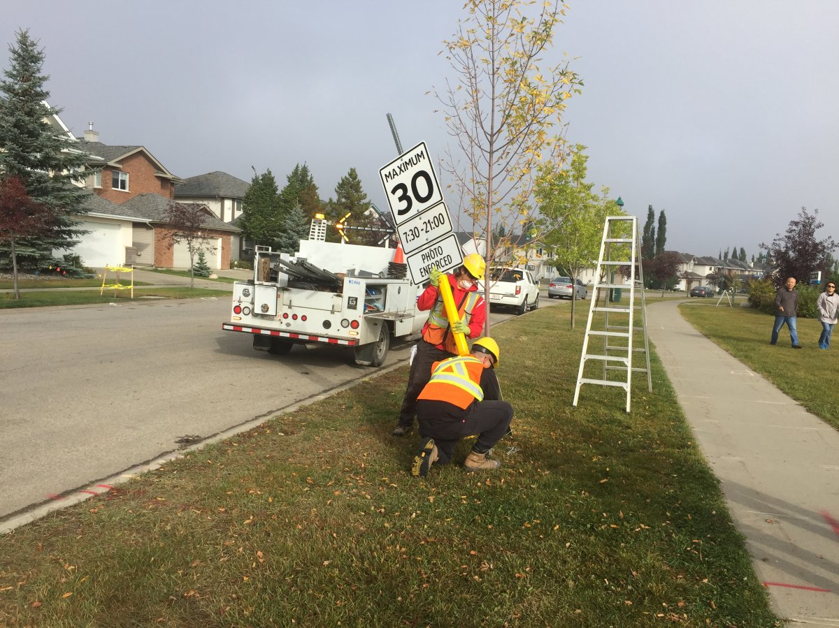 City of Edmonton crews install new 30 km/h speed limit signs in the Haddow neighbourhood in southeast Edmonton on Sept. 15, 2017.
