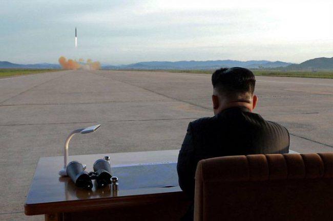 Kim Jong Un watches a missile launch
