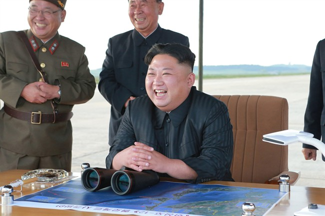 In this undated photo distributed on Saturday, Sept. 16, 2017, by the North Korean government, leader Kim Jong Un attends what was said to be the test launch of an intermediate range Hwasong-12 missile at an undisclosed location in North Korea.