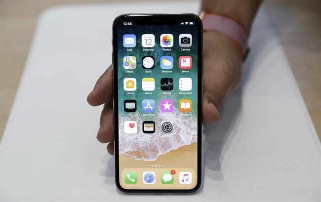 FILE - In this Tuesday, Sept. 12, 2017, file photo, the new iPhone X is displayed in the showroom after Apple's new product announcement.