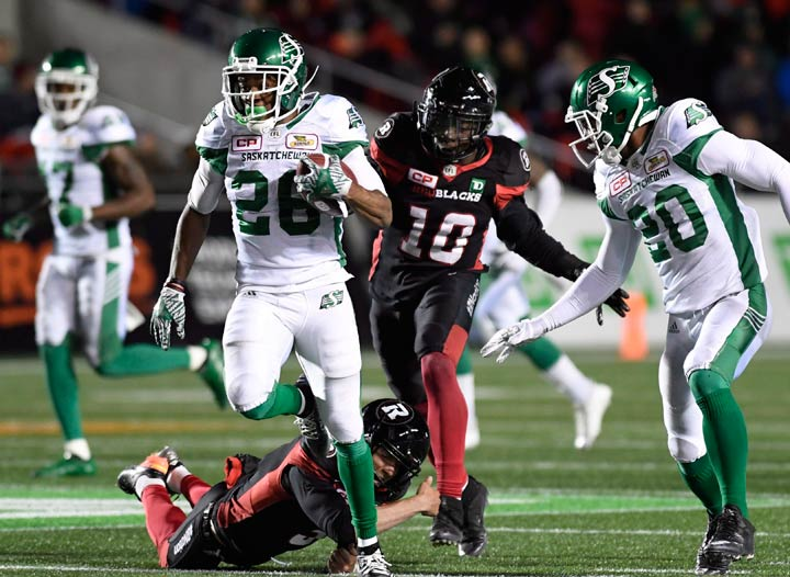 Saskatchewan Roughriders running back Christion Jones (26) runs past the Ottawa Redblacks to score a touchdown during second half CFL football action in Ottawa on Friday, Sept. 29, 2017. THE CANADIAN PRESS/Justin Tang