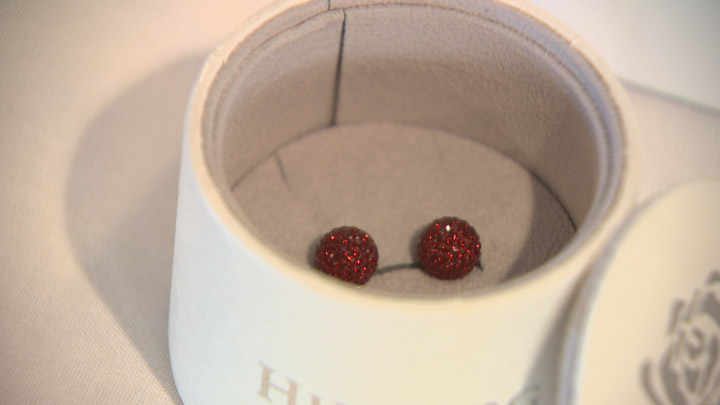 SFL selling burgundy sparkle ball earrings from Hillberg and Berk to support survivors of domestic violence in Saskatchewan.