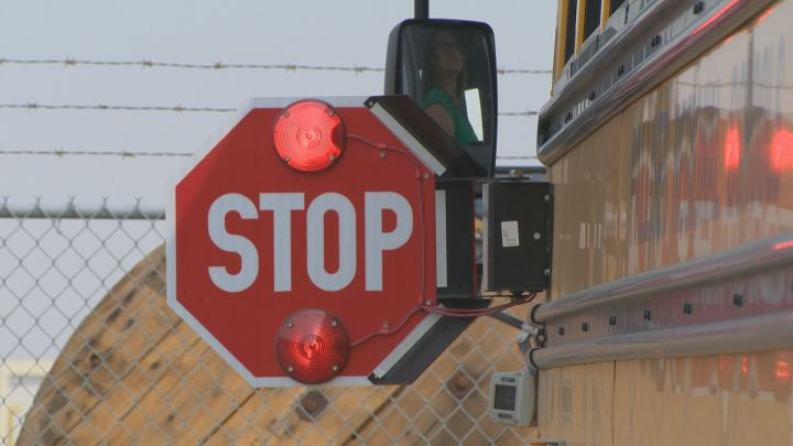 Guelph police say two drivers have been charged with passing a stopped school bus as students returned to in-person learning.