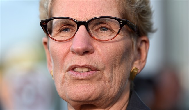 Ontario Premier Kathleen Wynne talks to media after appearing as a witness in the Election Act bribery trial in Sudbury, Ontario, Wednesday, Sept. 13, 2017.