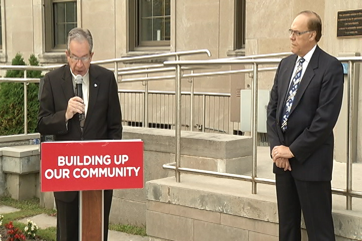 Peterborough MPP Jeff Leal, left, announces more than $2M for social housing repairs and retrofits in Peterborough on Thursday morning as Mayor Daryl Bennett looks on.
