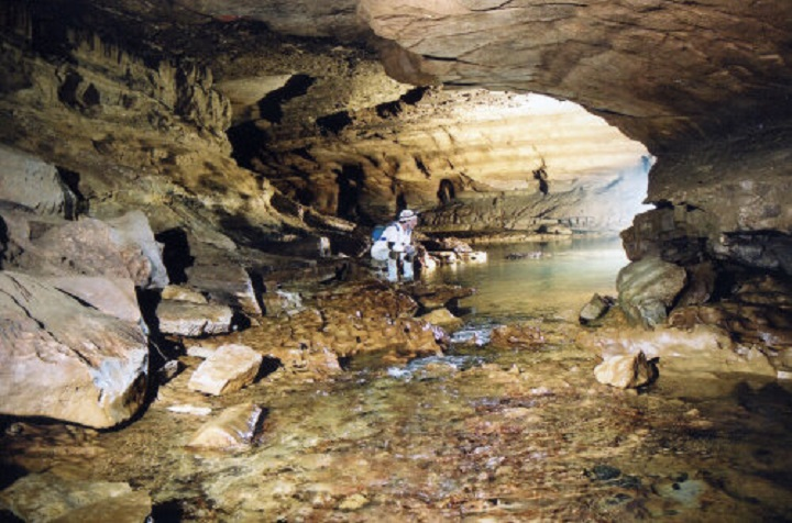 File photo shows a spelunker exploreing Sullivan Cave near Bloomington, Ind., where the university student was locked inside for 60 hours.