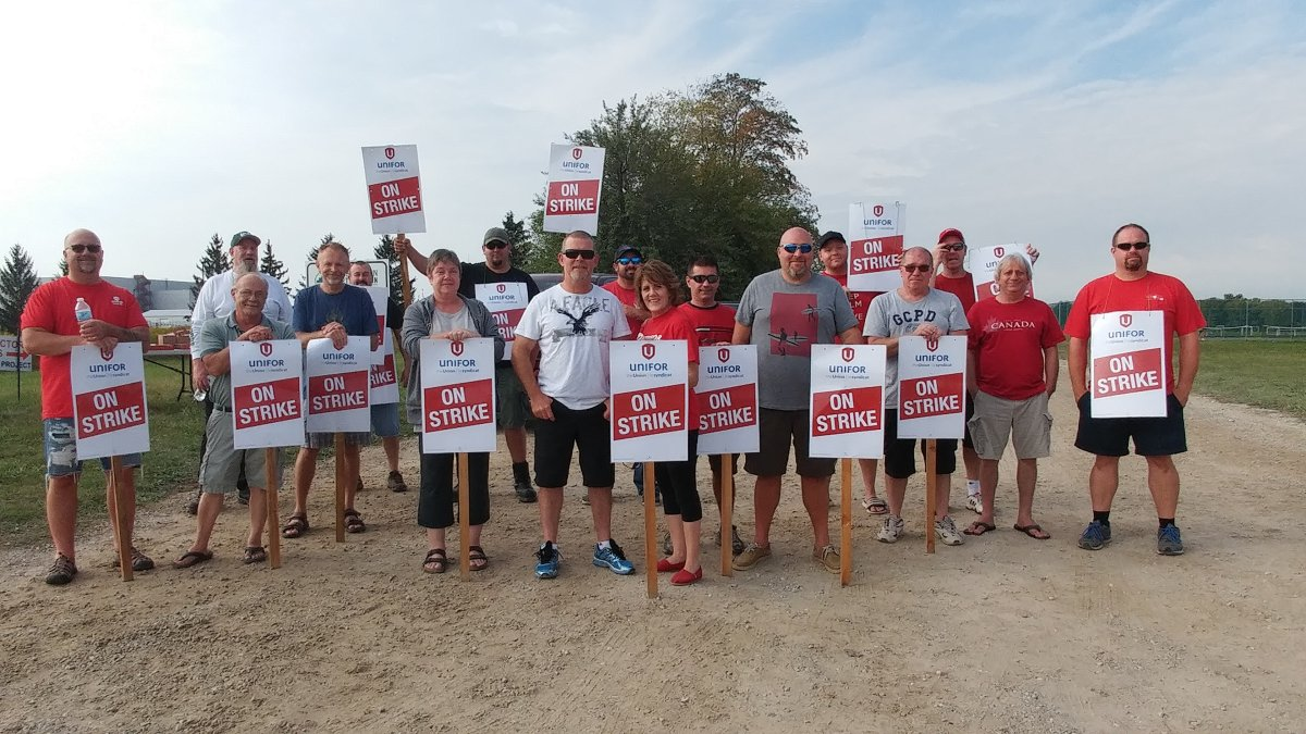 Members of Unifor local 88 hit the picket line outside the GM assembly plant in Ingersoll, Ont.