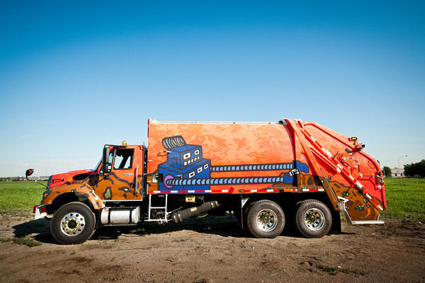 Art-wrapped City of Edmonton Waste Collection Vehicle by Edmonton Arts Council. Artist: Jeff Chan.