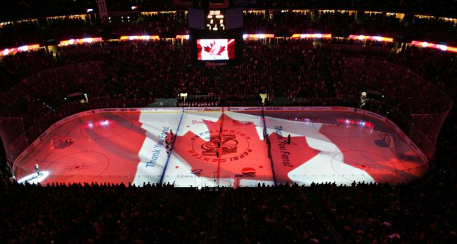 A Canadian flag illuminates the rink during the Canada national anthem before a Calgary Flames game, Oct. 10, 2005.