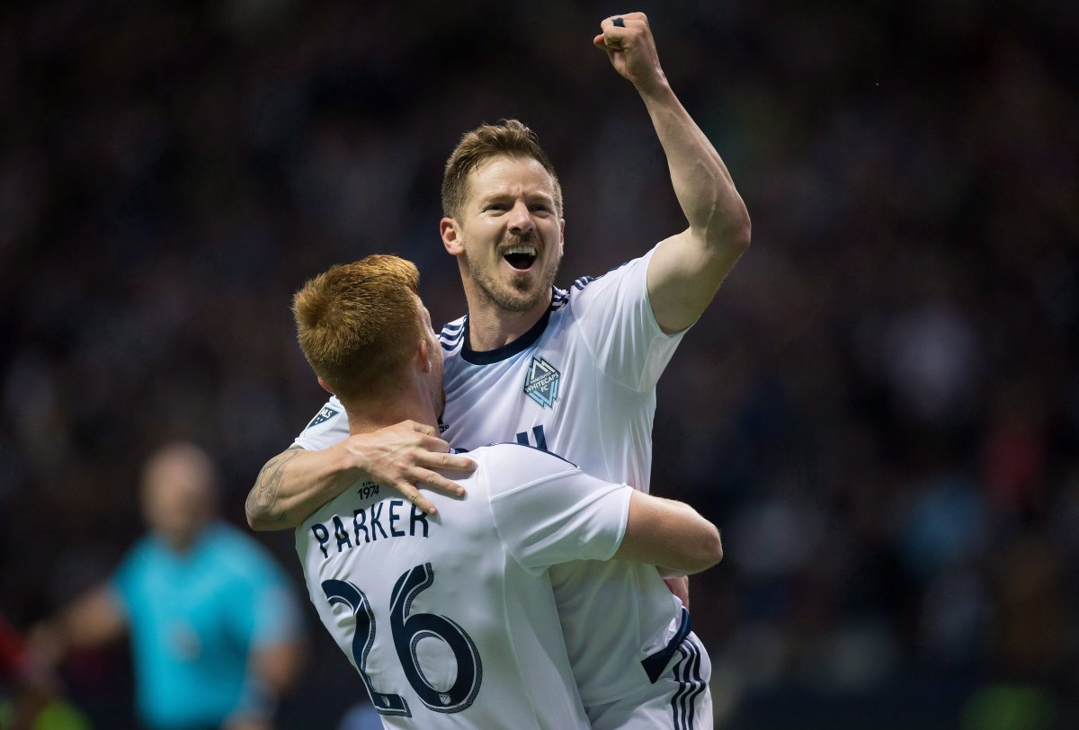 Vancouver Whitecaps' Jordan Harvey, right, and Tim Parker celebrate Harvey's goal against FC Dallas during the second half of an MLS soccer game in Vancouver, B.C., on Saturday April 23, 2016.