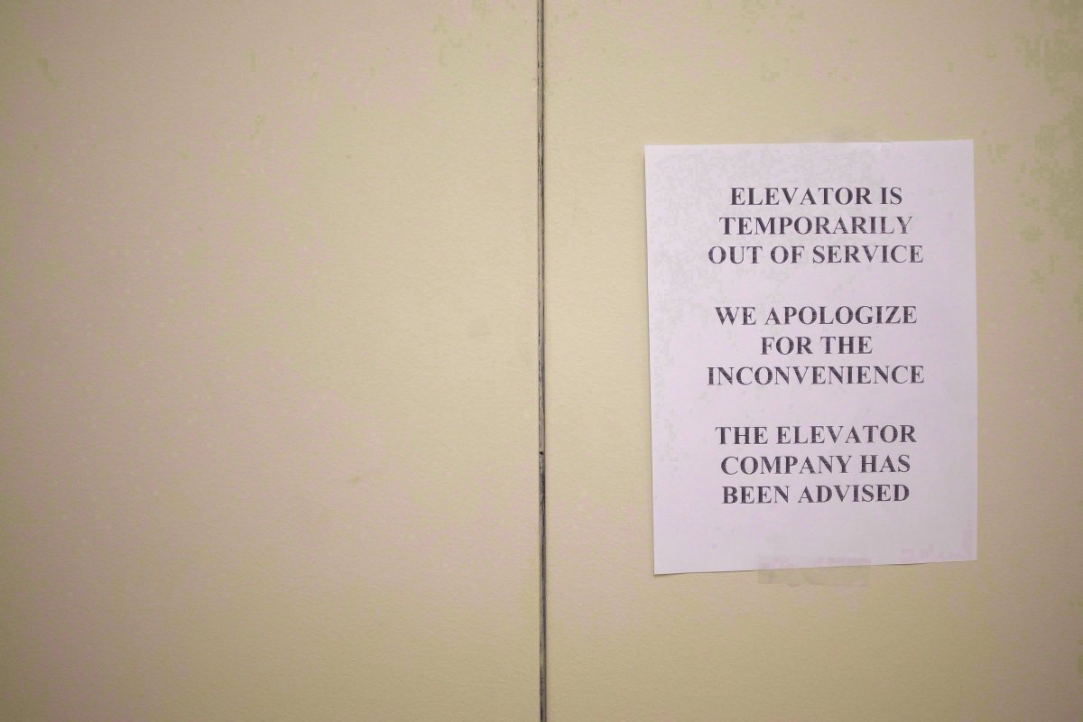 A sign is taped to a door of an elevator in a downtown Toronto office building on July 13, 2016.