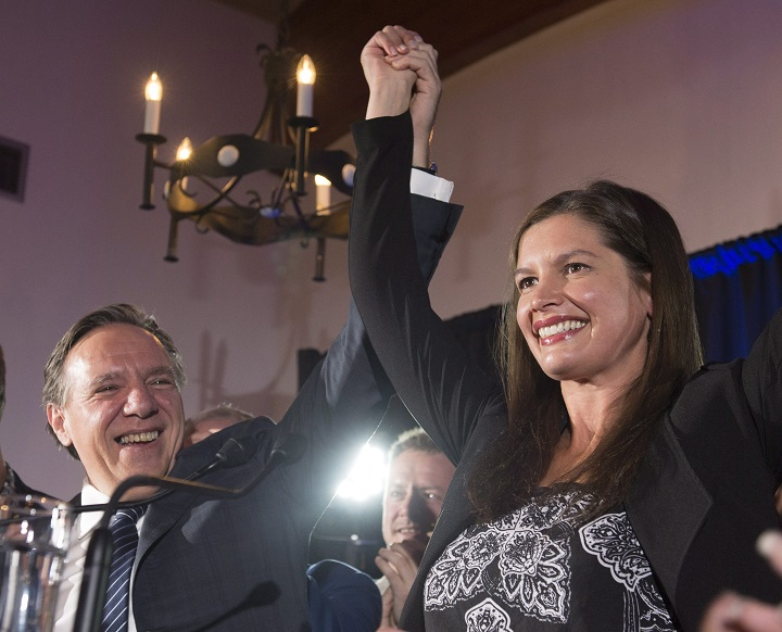 Coalition Avenir Quebec candidate Genevieve Guilbault celebrates her victory with leader Francois Legault, in a provincial by-election in the riding of Louis-Hebert, Monday, October 2, 2017 in Quebec City.
