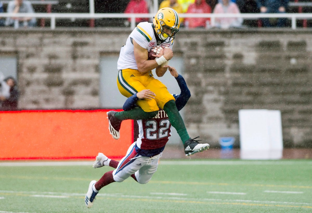 Edmonton Eskimos' Brandon Zylstra makes a catch as Montreal Alouettes' Greg Henderson defends during first half CFL football action in Montreal, Monday, October 9, 2017.