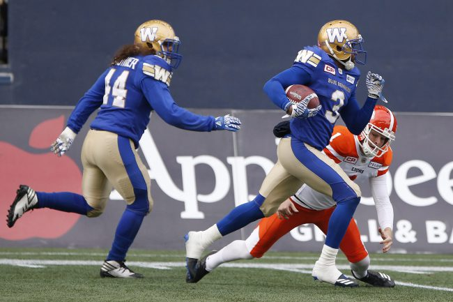 B.C. Lions kicker Ty Long (1) can't stop Winnipeg Blue Bombers defensive back Kevin Fogg (3) as he returns his kick for the touchdown during the first half of CFL action in Winnipeg on Saturday, October 14, 2017.