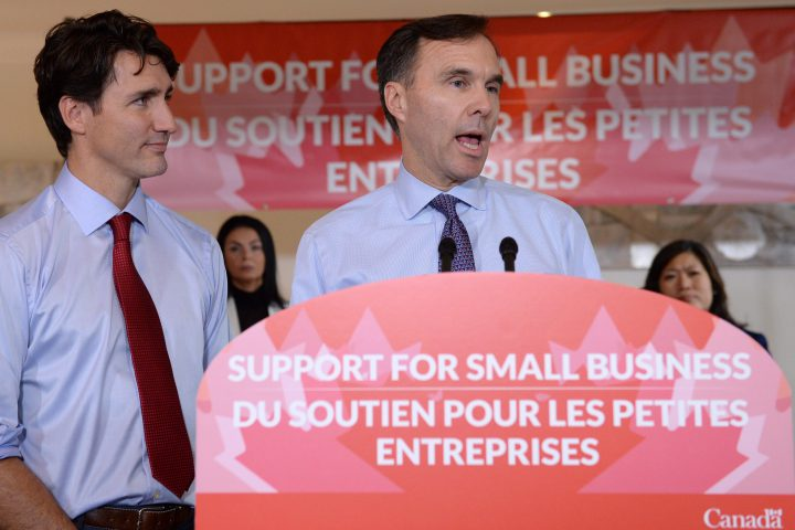 Finance Minister Bill Morneau speaks to members of the media as Prime Minister Justin Trudeau looks on at a press conference on tax reforms in Stouffville, Ont., on Oct. 16, 2017.
