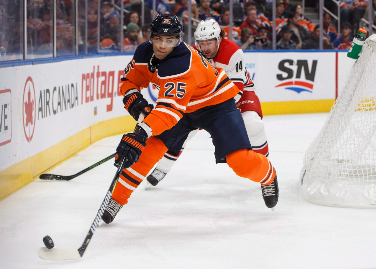 Carolina Hurricanes' Justin Williams (14) chases Edmonton Oilers' Darnell Nurse (25) during first period NHL action in Edmonton, Alta., on Tuesday, October 17, 2017.
