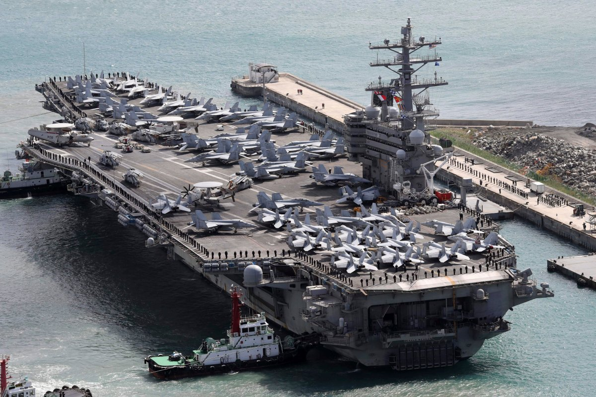 """U.S. naval commanders on Saturday reiterated Washington's """"ironclad"""" commitment to defend South Korea against North Korean threats as the American nuclear-powered aircraft carrier visited a South Korean port following a joint naval drill."""