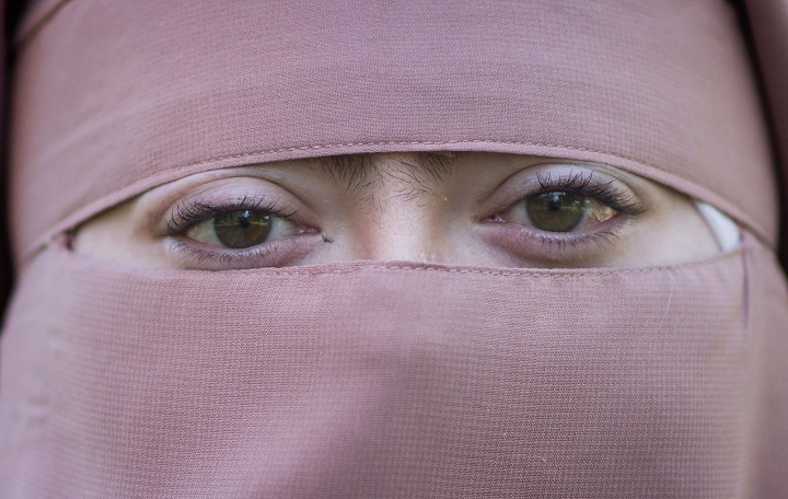 Warda Naili poses for a photograph at a park in Montreal, Saturday, October 21, 2017. Under Quebec's new religious neutrality law anyone giving or receiving a public service will be required to uncover their face.
