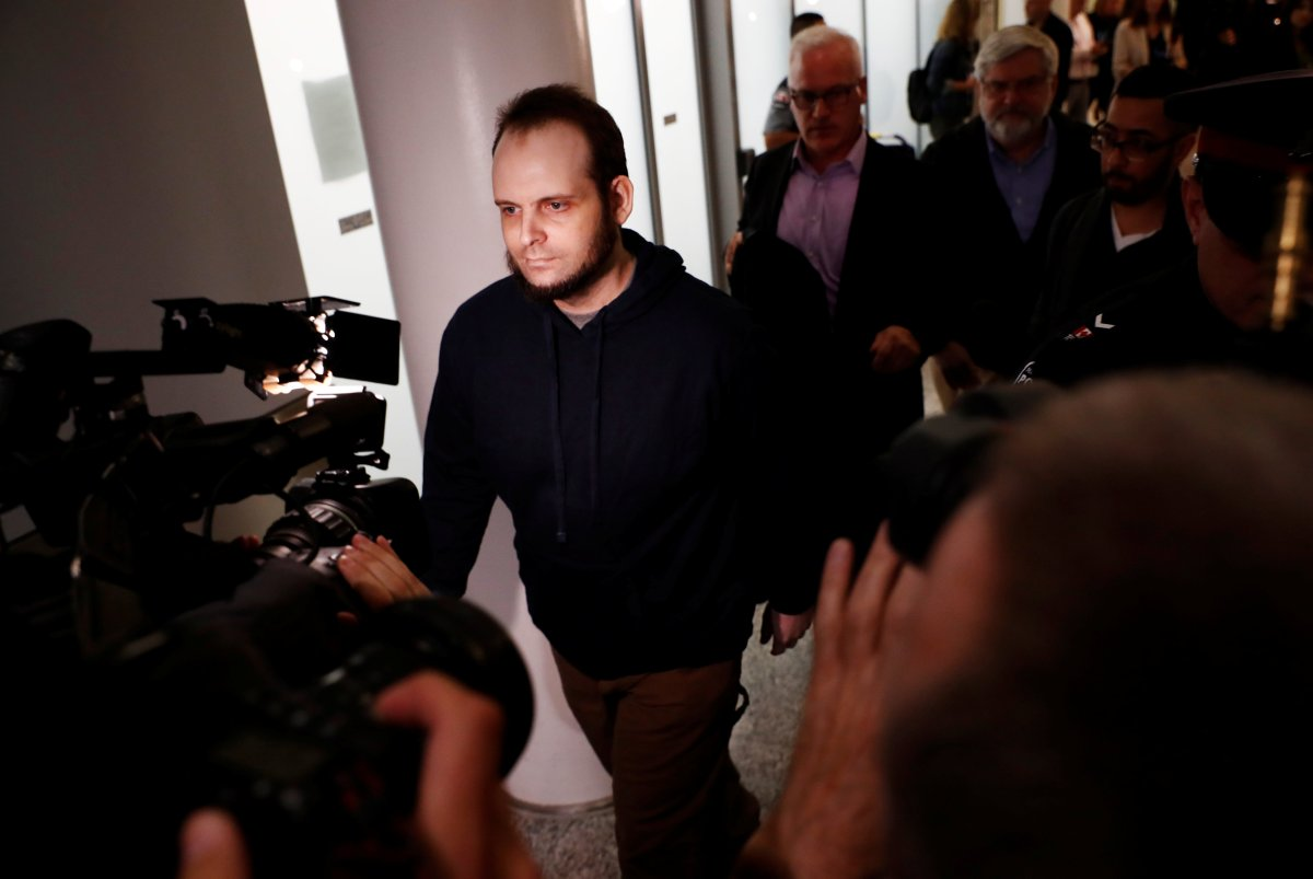Joshua Boyle walks through the airport after arriving with his wife and three children at Toronto Pearson International Airport, nearly 5 years after he and his wife were abducted in Afghanistan in 2012 by the Taliban-allied Haqqani network, in Toronto, Ontario, Canada, October 13, 2017.    REUTERS/Mark Blinch.