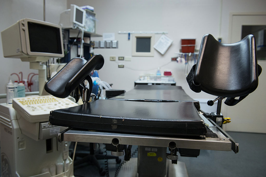 An exam table stands in an operating room at an abortion clinic.