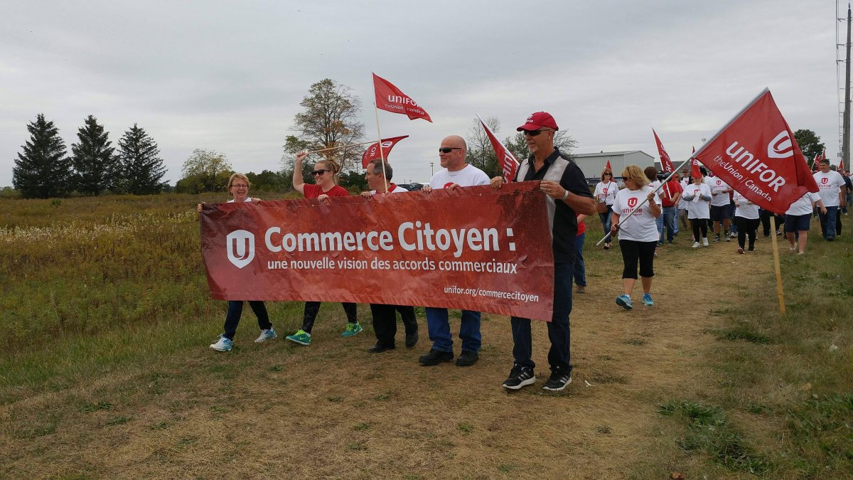 Hundreds marched in solidarity with unionized workers on strike at General Motor's CAMI plant in Ingersoll, Ont.